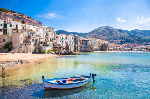 Fotografie, Obraz  Old harbor with wooden fishing boat in Cefalu, Sicily