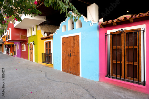 Tuinposter Mexico Bright facades of traditional Mexican architecture, Puerto Valla