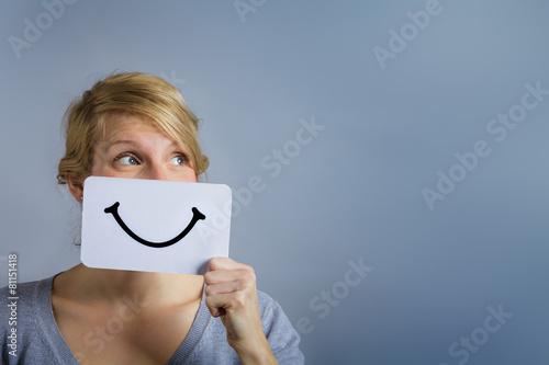 Valokuvatapetti Happy Portrait of Someone Holding a Smiling Mood Board