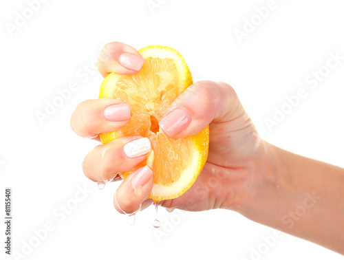 female hand squeezing lemon isolated on white buy this. Black Bedroom Furniture Sets. Home Design Ideas