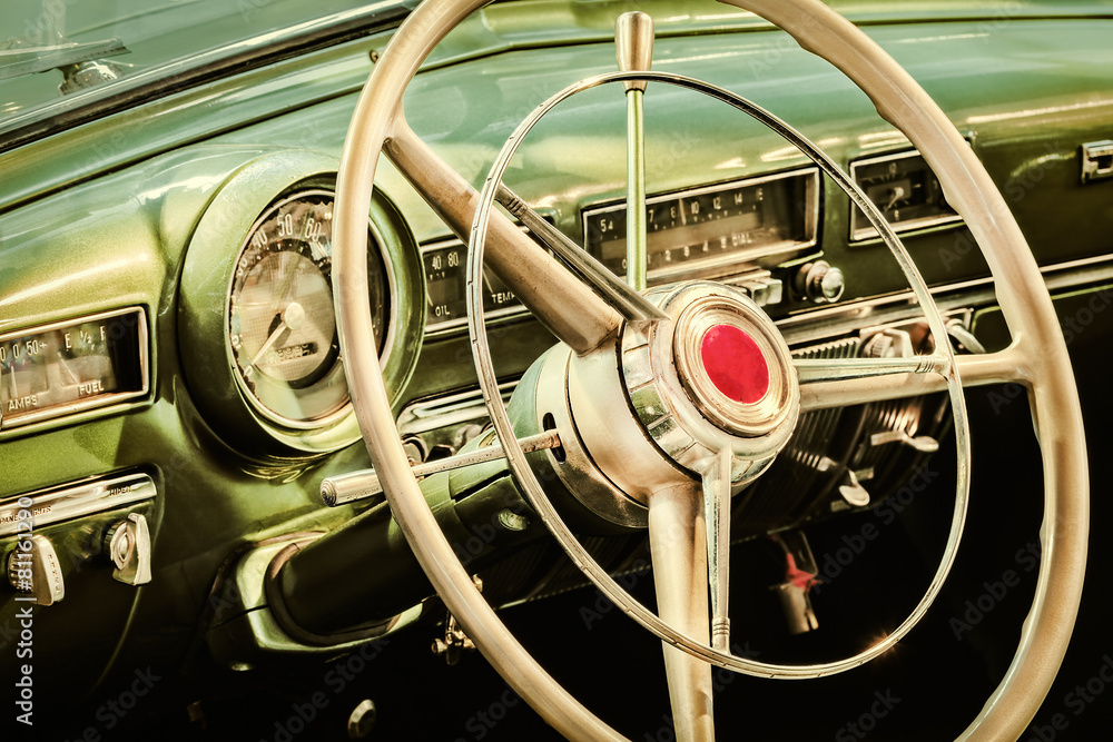 Fototapeta Retro styled image of the interior of a classic car