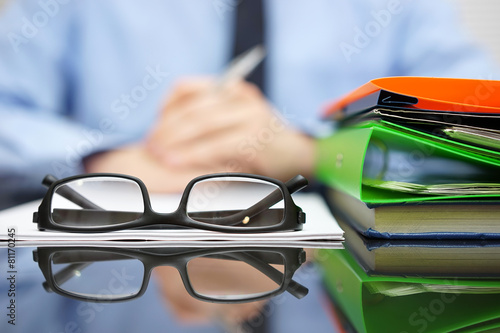 Fotografie, Obraz  Businessman is reading or thinking in front of contract and docu