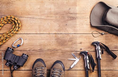 Obraz na płótnie Equipment for hiking on a wooden floor background