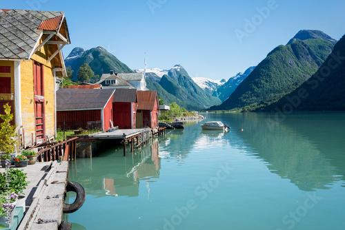 Fotografie, Obraz  Fjord, mountains, boathouse and reflection in Norway