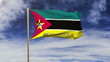 Mozambique flag with title waving in the wind. Looping sun rises