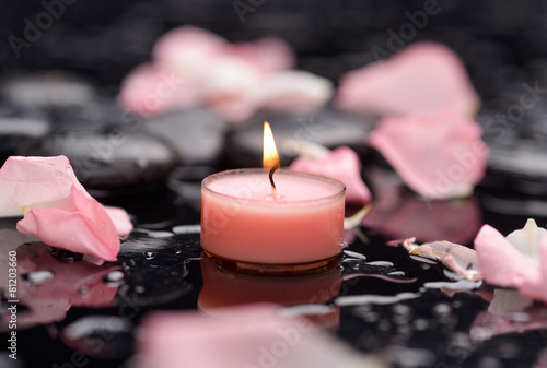 Staande foto Spa rose petals with candle and therapy stones
