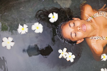 Beautiful Exotic Woman Having Bath In A Luxury Spa Salon