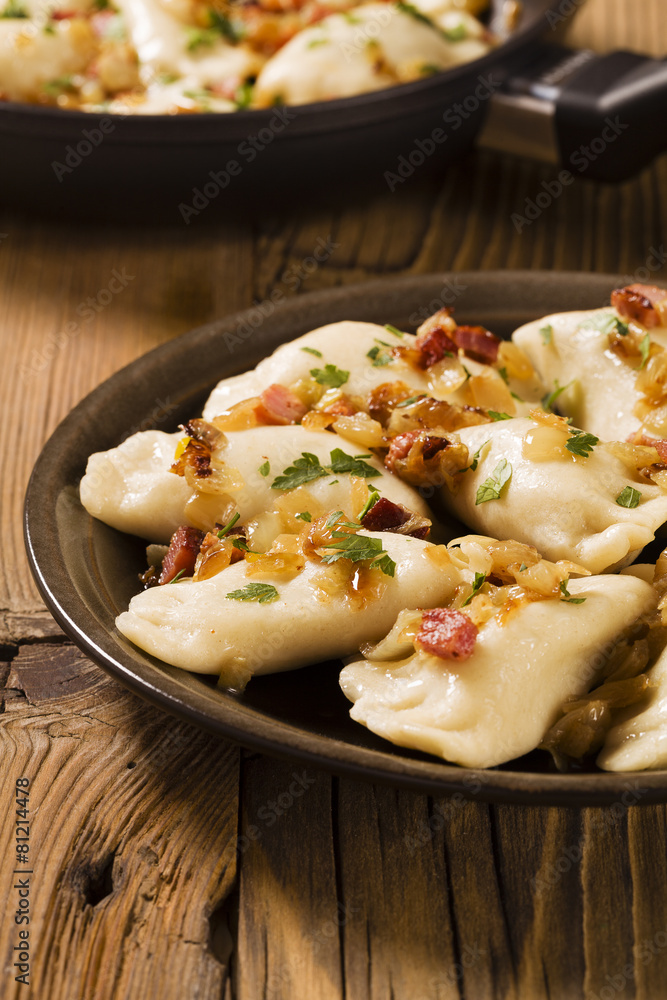 Obraz Delicious homemade dumplings with onion and bacon fototapeta, plakat