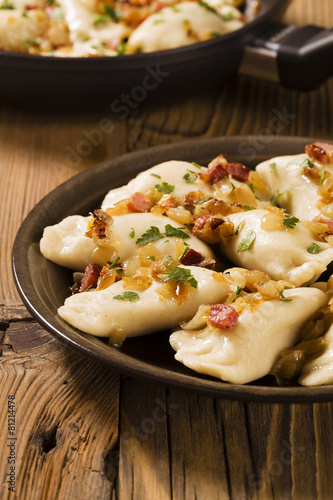 Fototapeta Delicious homemade dumplings with onion and bacon obraz