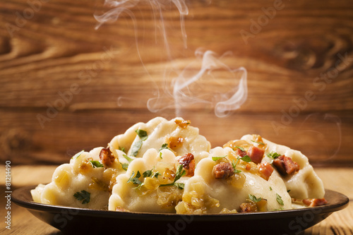 Delicious homemade dumplings with onion and bacon #81214490