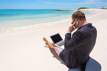 Businessman Working On The Beach