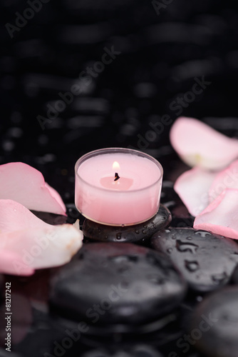 Staande foto Spa pink rose petals with pink candle and therapy stones