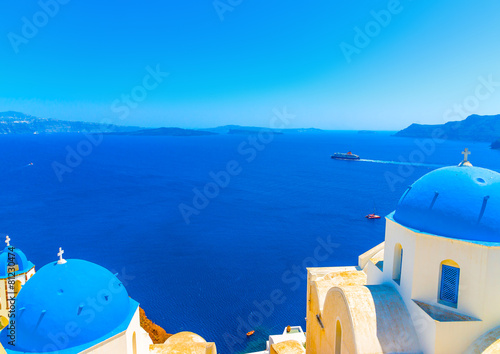 Foto op Aluminium Santorini churches with blue domes in Oia at Santorini island in Greece