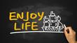 enjoy life and sailing boat hand drawing on blackboard