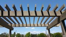 Portland Wooden Backyard Pergola Against Blue Sky
