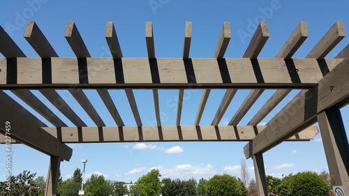 Fotografia  Portland wooden backyard pergola against blue sky