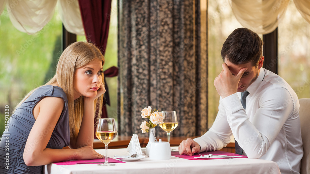 Fototapety, obrazy: Couple is getting bored on first date