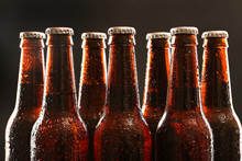 Glass Bottles Of Beer On Dark ...