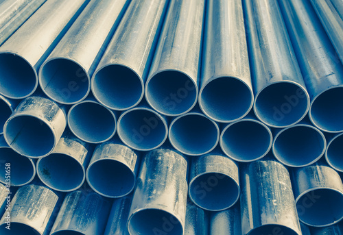 Fotografia  Close - up Stack of construction metal pipes .