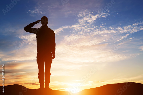 Soldier salute. Silhouette on sunset sky. Army, military. Canvas-taulu