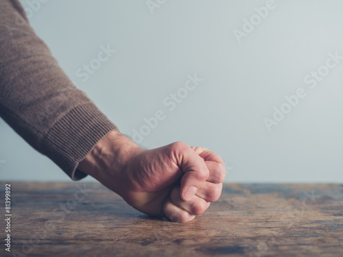 Man slamming his fist on table Canvas Print