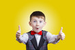 canvas print picture - Excited Surprised little boy with thumb up gesture