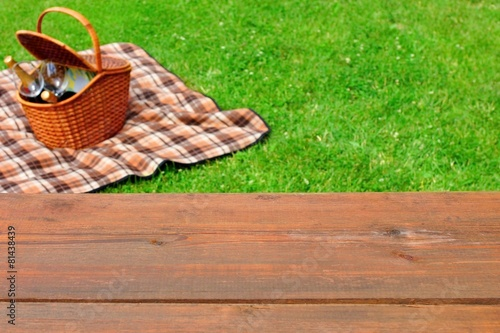 Keuken foto achterwand Picknick Picnic Tabletop Close-up. Picnic Basket and Blanket On The Lawn