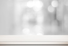 Empty White Table And Blurred Store Bokeh Background