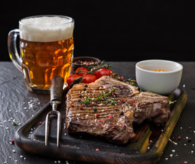 FototapetaBeef rump steak on black stone table