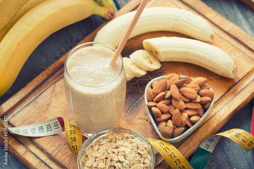 Poster Milkshake Fresh made Banana smoothie on wooden background
