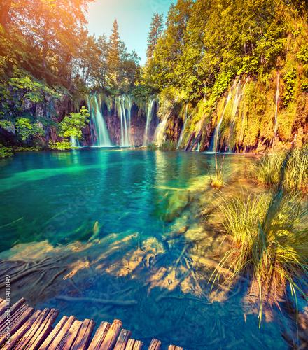 Fototapeten Wasserfalle Colorful summer morning in the Plitvice Lakes National Park. Cro