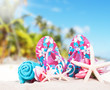 flip-flops with tropical beach background, summer accessories