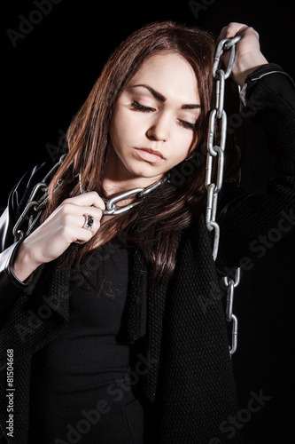 Fotografie, Obraz  Beautiful young woman with chains