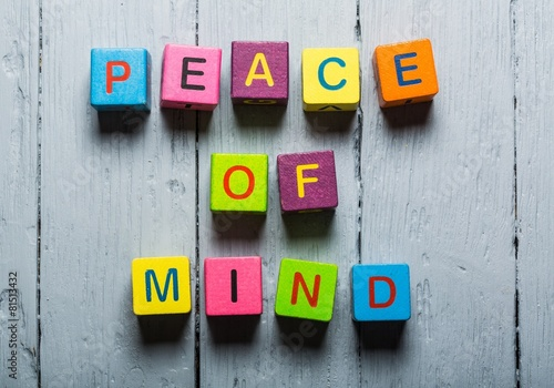 Photo  Mind. Peace of Mind wooden sign with a beach on background