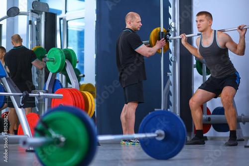 Foto op Plexiglas Fitness Bodybuilder with barbell in gym