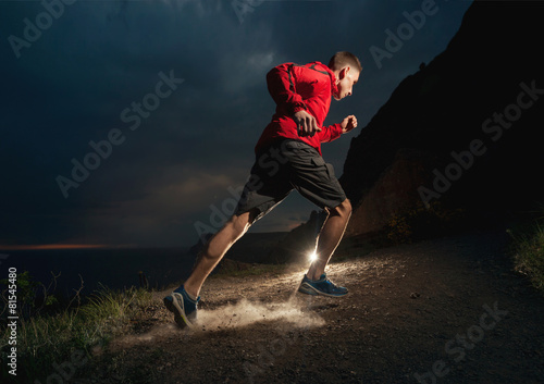 Man running in the mountains at night.