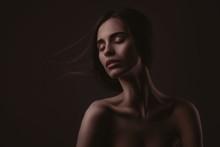 Beautiful Woman Over Dark Background