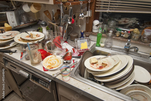 Dirty dishes over flowing in a kitchen sink - Buy this stock photo ...