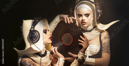 Foto  The girl - a nun in the form of a DJ