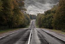 Dark Asphalt Road Under A Storm Sky