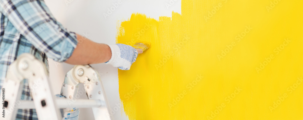 Fototapety, obrazy: close up of male in gloves painting a wall