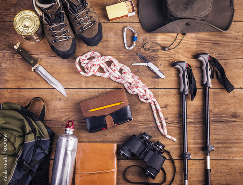 Fotografia  Equipment for hiking on a wooden floor background