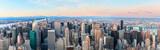 Fototapeta Nowy York - New York City skyline with urban skyscrapers at sunset.