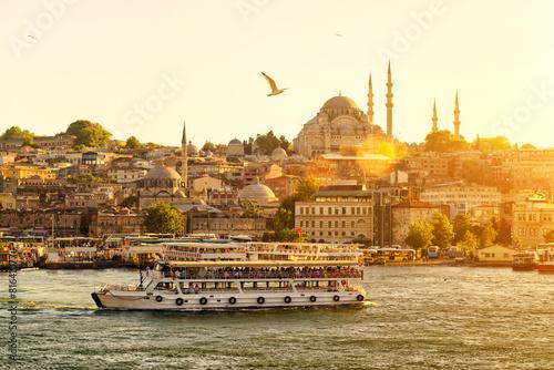 Tourist ship sails in Istanbul, Turkey Fototapeta