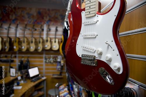 Spoed Foto op Canvas Muziekwinkel guitar in a music store