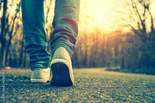 Woman jeans and sneaker shoes Wallpaper Mural