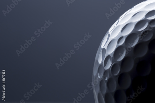 Aluminium Prints Golf Stylish golf ball isolated on empty dark blue background.