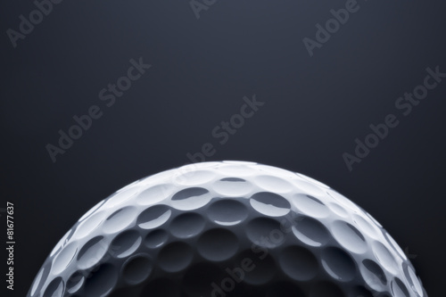 Acrylic Prints Golf Macro golf ball on dark blue background, space for text.