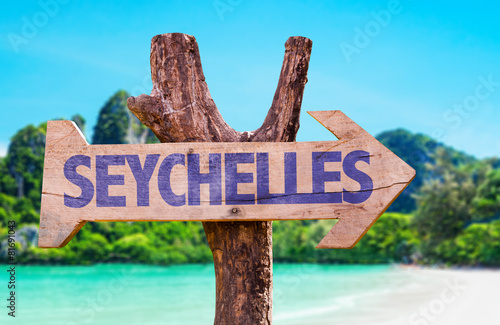 Seychelles wooden sign with beach background Canvas Print