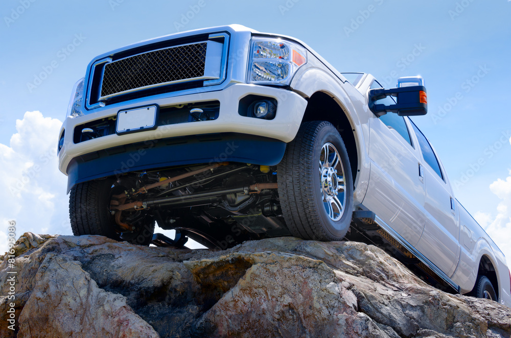 Fototapety, obrazy: White truck on cliff edge showing undercarriage